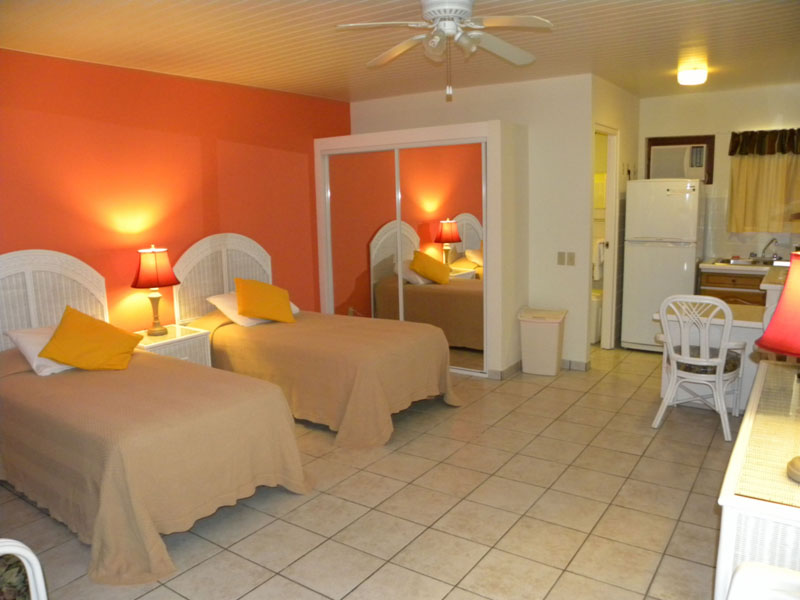 Closed Door To Kitchen And Bed Aruba Quality Apartments